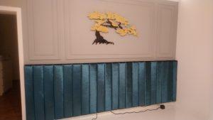 Wandpolsterung als Bettkopfteil aus einzeln bezogenen Pfeifen